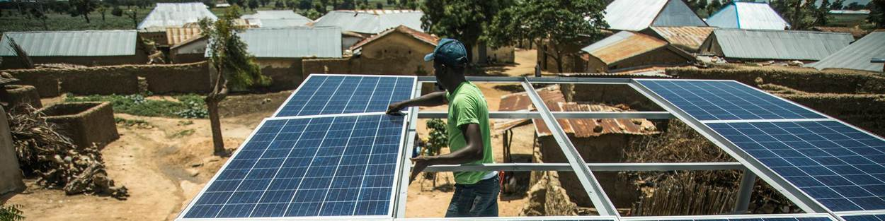 Sonai Energies Kaduna state Nigeria - man with solar panel